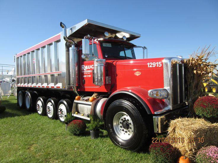 Red 6 axle Peterbilt dump truck