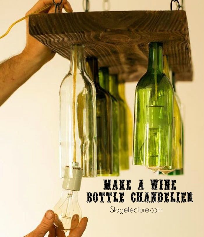 How to Make a Bottle Chandelier Tutorial. Watch the video to recycle your old wine bottles into a lighting fixture. #DIY #project #craft