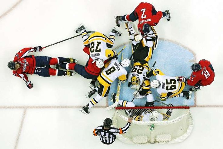 CROWDING THE NET:    Goalie Marc-Andre Fleury (29) of the Pittsburgh Penguins makes a save as Pittsburgh Penguins and Washington Capitals players battle for the puck in the first period in Game One of the Eastern Conference Second Round during the 2017 NHL Stanley Cup Playoffs at Verizon Center on April 27, in Washington, DC. The Pittsburgh Penguins won, 3-2.