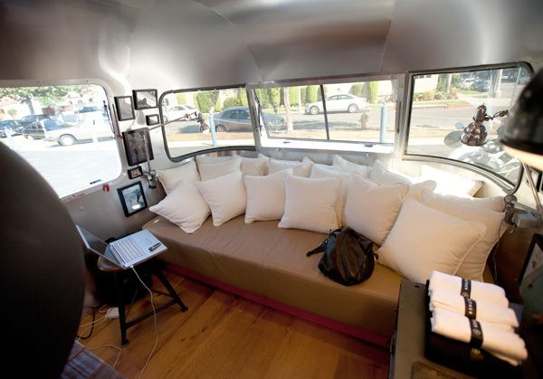 Vintage Airstream Interiors | Aetherstream interior; the nose-end has a custom-designed sofa ...