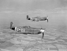 Two Royal Air Force North American Mustang Mark Is (AG550 'XV-U' and AM112 'XV-X') of No. 2 Squadron RAF based at Sawbridgeworth, Hertfordshire, in flight over Cambridgeshire (UK). AG550 is being flown by Wing Commander A.J.W. Geddes, the squadron commander. Photo by B.J. Daventry, Royal Air Force official photographer via IWM