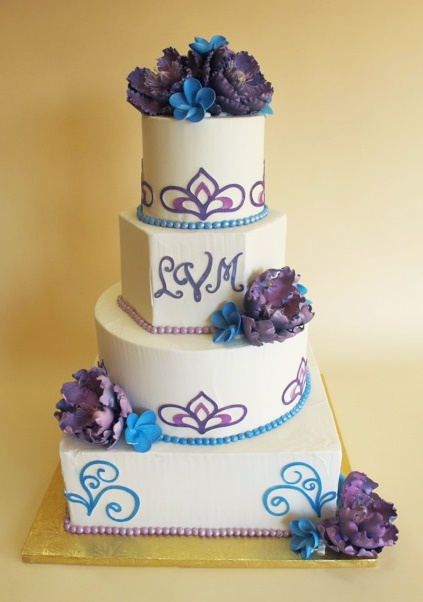 I'm not sure if I like the different shaped tiers, but I love the piping and flowers!