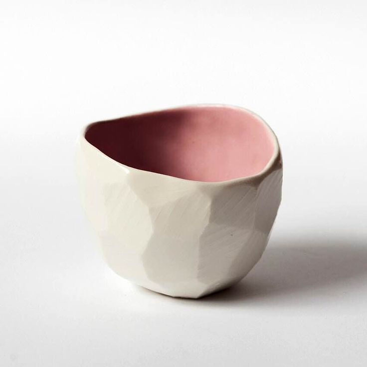 """These diamond pots by Skandihus have all been hand made using a technique called """"pinching"""" where the pot is formed from one ball of clay. Each diamond is unique and they all vary in the size and shape. The pots can be used for tea lights, plants, salt or as small coffee cups. Approx H 8cm - W 7cmSkandiHus was founded by Danish ceramicist, Stine Dulong, who works and lives in London.The SkandiHus brand is inspired by a love for Scandinavian design in which ..."""