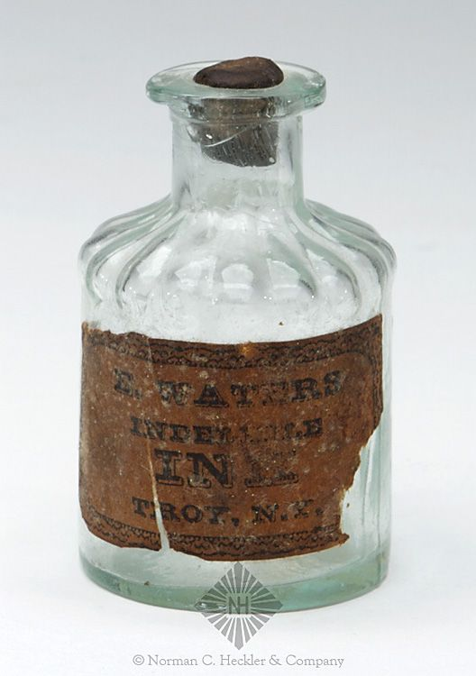 """E. Waters / Troy NY"" Ink Bottle, America, 1840-1860. Cylindrical with fluted shoulders, aquamarine, applied square collared mouth - pontil scar, ht. 2 7/8 inches, dia. 1 3/4 inches. Similar to C #208 Great partial original label, interesting bubble pattern in glass. #Bottles #Ink #MADonC"