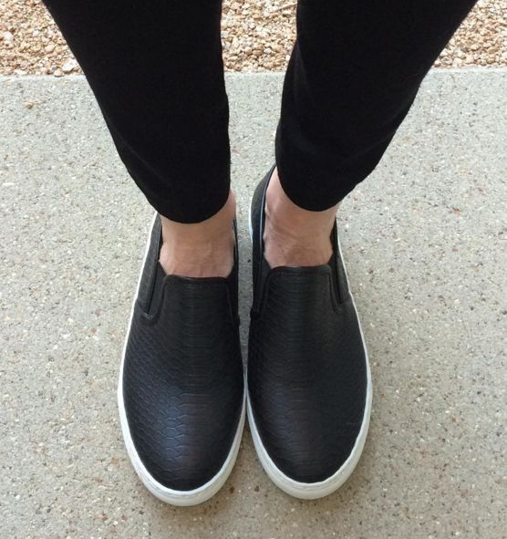 The new everyday slip-on snakeskin sneaker! This sneaker resembles the Steve  Madden style! Black Faux Snakeskin top w/elastic at sides White soles Comes  in