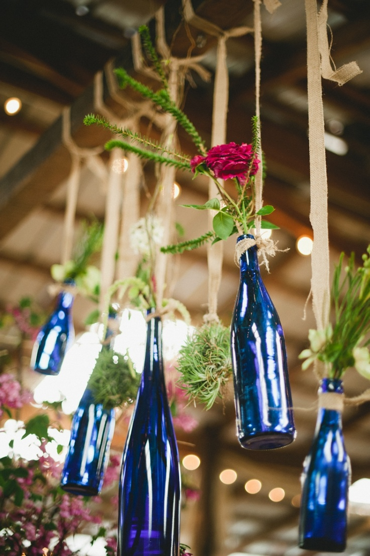 {Rustic Wedding} Wine bottles hung from the ceiling!