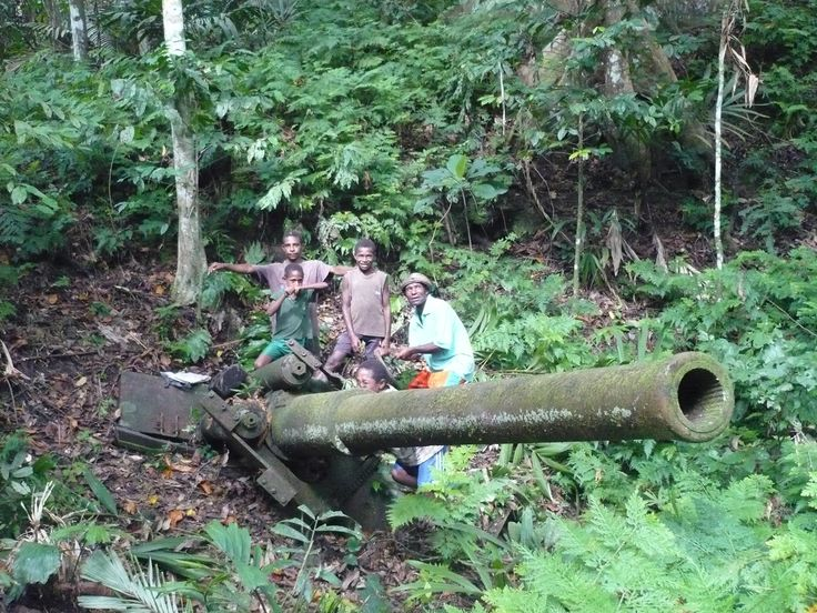 PNG Locals visiting a WWII war relic in the jungle.   http://www.pagahillestate.com/exploring-world-war-ii-relics/