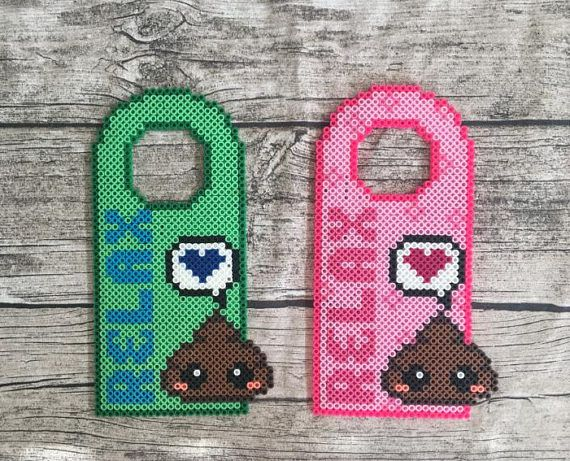 Let everyone know that your bathroom is OCCUPADO so you can do your Number Two in peace with these adorable, handmade Perler bead door hangers. Perfect for small children - or adults with the scatological sense of humor of small children! The door hangers are 24 cm (9 1/2) long and 11 cm (4 1/4) wide. The hole for the door knob is 6 cm (2 1/4) in diameter and should fit most standard door knobs. ***FREE LOCAL PICKUP. FREE LOCAL DELIVERY ON ORDERS OVER $30*** Please note that...