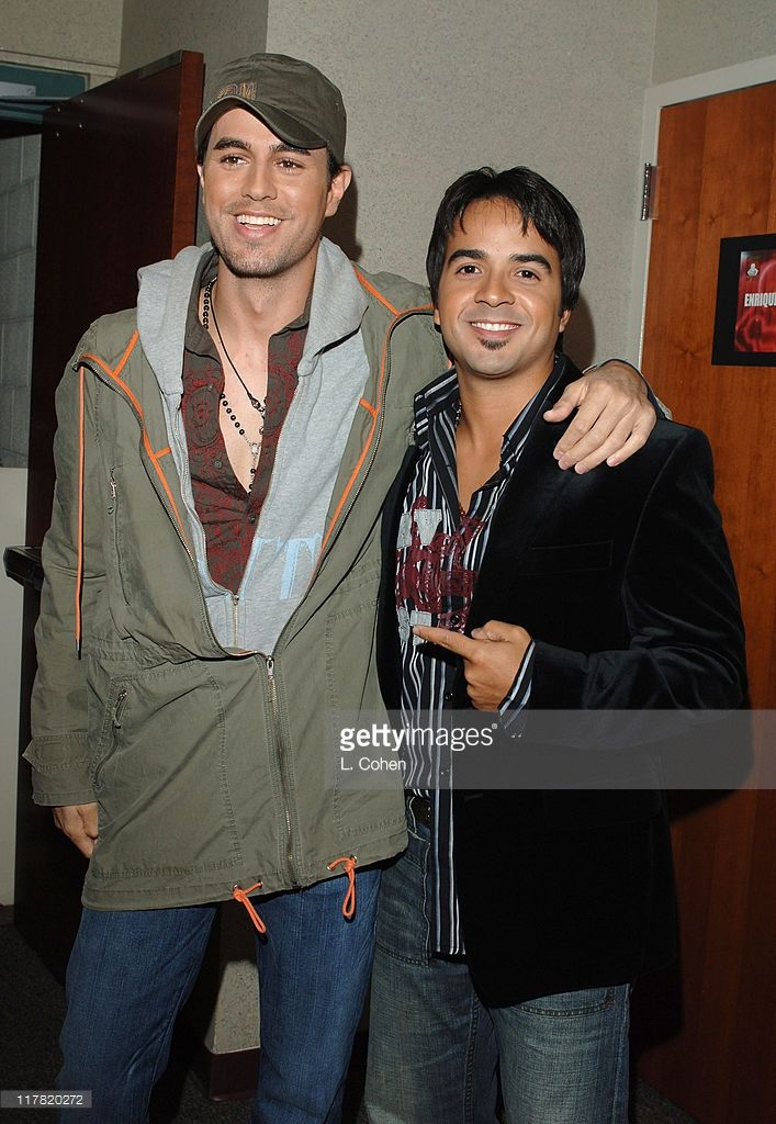 Enrique Iglesias and Luis Fonsi during A Very Special Christmas - Una Noche de Paz - Reception and Backstage at Arrowhead Pond in Anaheim, California, United States.