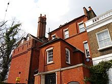 """West House is a Grade II* listed Queen Anne revival house at 35 Glebe Place, Chelsea, London. It was built in 1868–69 by the architect Philip Webb, on behalf of the artist George Price Boyce. It was extended in 1876 by Webb, and in 1901 by an unknown architect. Historic England have described West House as """"one of the earliest examples of the Queen Anne Revival style"""""""