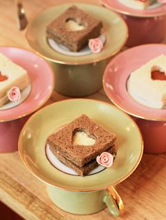 Tea party idea: Use cookie cutters to create little peek-a-boo shapes! Then serve the tea sandwiches on an upside down cup and saucer.