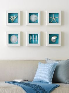 shells, white shadow box frames,brilliant blue background = beach inspired wall art
