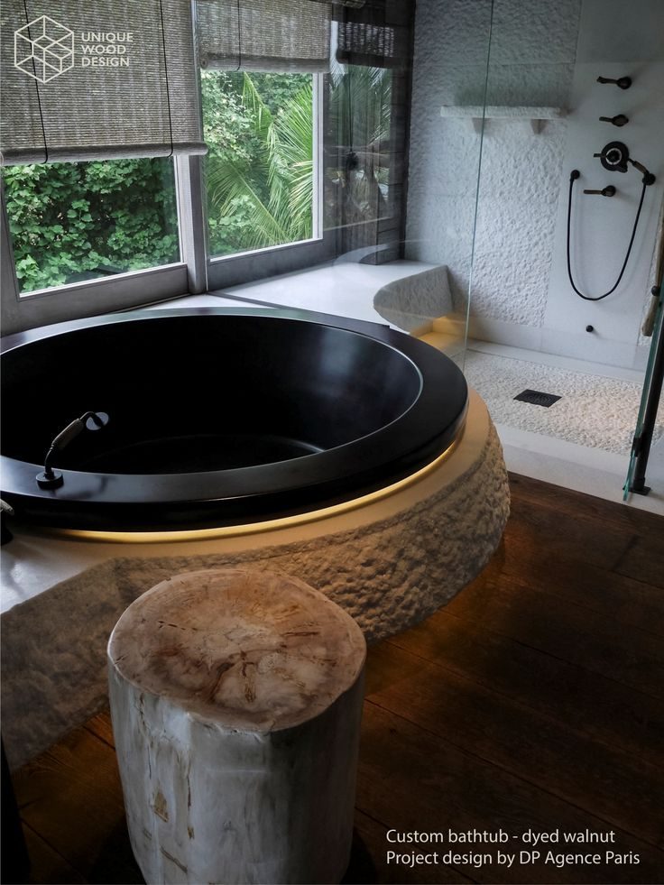 Unique Wood Design. Custom wooden bathtub made in Walnut dyed to almost pitch black. Project by DP Agence Paris