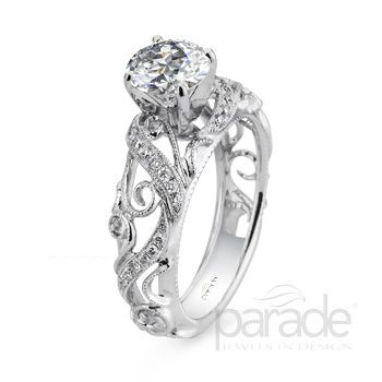 from Parade Design Parade's vintage-inspired design is anything but your basic engagement ring, milgrain etched scrolls curl and climb toward a show-stopping brilliant-cut diamond.