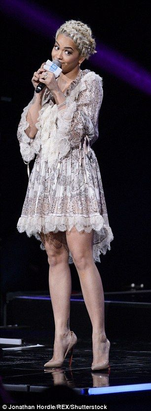 Check out the dress:The musician wore a pretty paisely print dress for the event at Wembley Arena