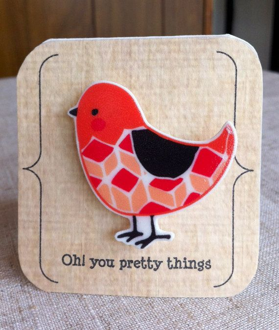 Broche oiseau géométrique orange sur Etsy, 8,12€