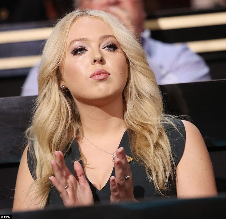 She applauds while listening to speeches at the Quicken Loans Arena during the highly-charged event