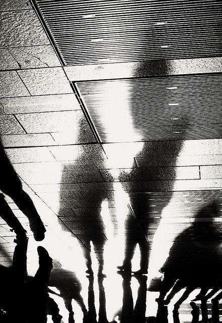 This people seem like they are reflecting themselves with their shadows, they are hiding from what reality really is   Shadow Street Photography * Giacomo Coppo