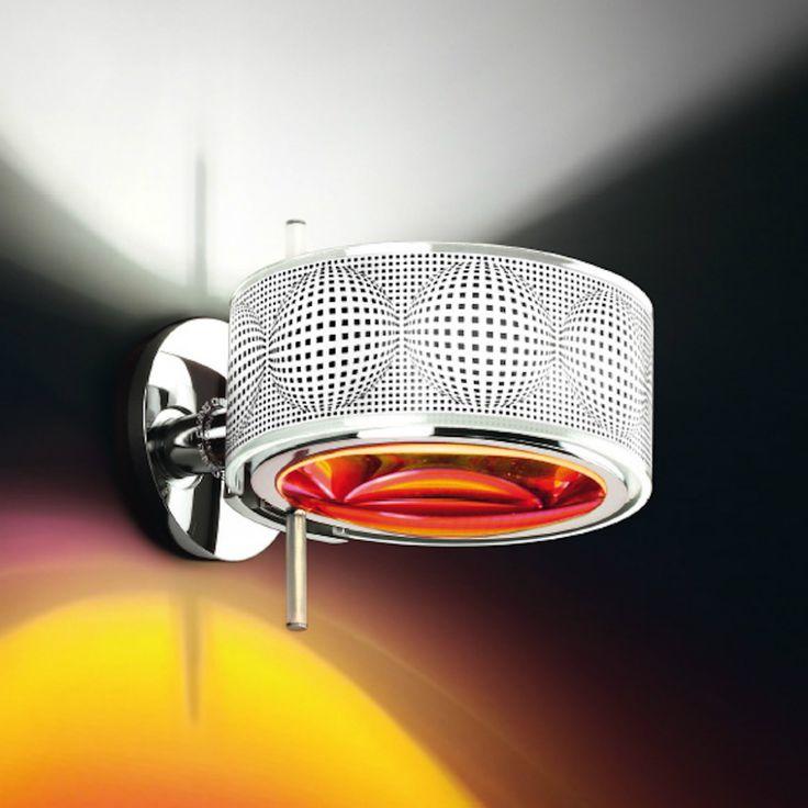 Cini e Nils Componi, una lampada da parete personalizzabile. Si puà comporre secondo gusti, preferenze e necessità scegliendo la lente, l'anello, la struttura e i dischi colorati.