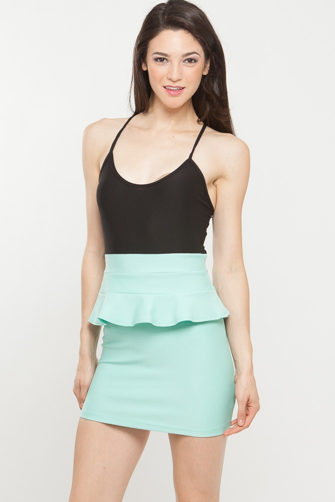 This two tone dress channels the best of minimalist with its modern peplum appeal. Features solid black bodice contrasted with mint peplum waist silhouette. Cross spaghetti strap. Looks gorgeous with classic black pumps and leather jacket. Gotta love the simplicity of black with a mint especially on a peplum skirt! Check it out on www.CiCihot.com #CiCihot #fashion #springstyle #fashionista #welovefashion #peplum #mint #dress