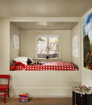 Sleeping alcove created from an old closet space gives this bedroom much more open floor space for playing...