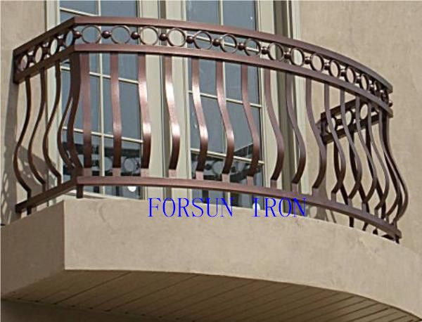 Wrought Iron Balcony Railing  nice shape, but the bars are too wide and the circles could be waves