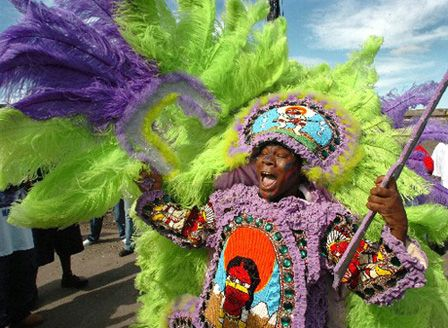 """Mardi Gras Indian: the tradition pre-dates """"white Mardi Gras,"""" the reconstruction-era social platform for segregation and """"Southern"""" dominance. Ritualistic resilience and resistance still win on the streets at Carnival."""