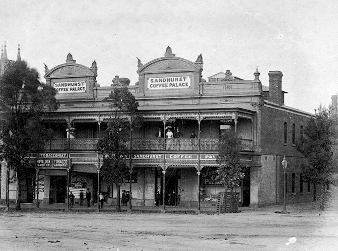The Sandhurst Coffee Palace. There are a number of people standing on the balcony and in front of the building. There is a tobacconist on the left. Mitchell Street, Bendigo, Victoria, Australia, 1890 W H Robinson Studio, 1890