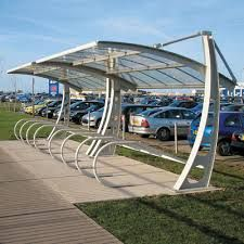 Transit is a durable,anodized aluminum bike shelter with internal rain gutters,3 roof styles and clear tempered glass side & rear panels. http://velodomeshelters.com