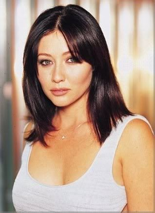 Shannon Doherty.  I think she is absolutely DROP DEAD GORGEOUS.