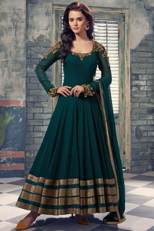 Green Georgette Anarkali churidar suit. Hand embroidered Neck and shoulder. U Neck ,Floor length, full sleeves kameez/ top. Green Shantoon churidar. Green dupatta with golden border. Product are available in 34,36,38,40,42, 44, 46, 48 sizes. It is perfec