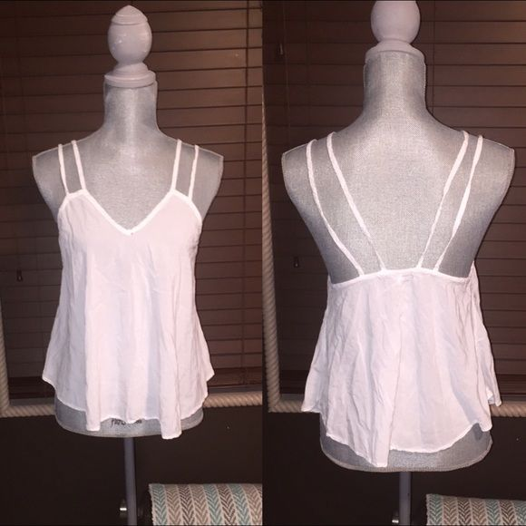 Brandy Melville Sheer White Tang Top High - low white loose fitting Brandy Melville tang top. Perfect for summer time or under a cardigan. It's sheer but pretty with lace bra or strappy type bra. Never worn but has tiny whole it was sent to me that way. Brandy Melville Tops Camisoles