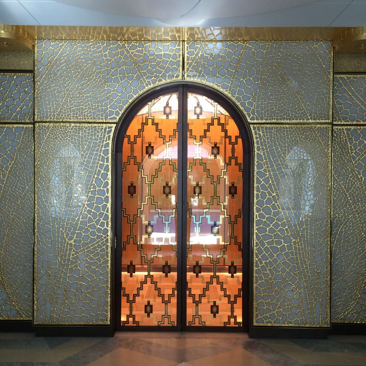 Back lit dragonfly wing patterned walls in bronze by Michele Oka Doner and doors in verre eglomise by Miriam Ellner