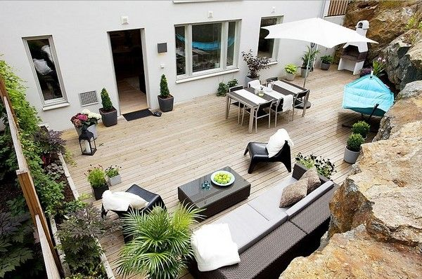 outdoor seating area...courtyard, full glass wall of doors to the house.