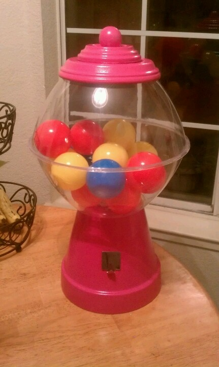 I made this huge gumball machine using a large planter pot and two dollar tree chip bowls. You just spray paint the pot and the drip part, fill a bowl with ball pitt balls, glue gun the two bowls together and to the planter pot and for the top add a wooden knob to the drip plate... I used a dollar store hook for the dispenser part.