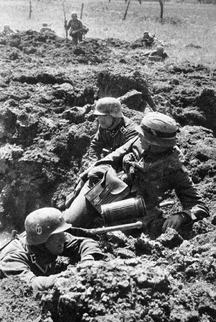 Waffen SS in trenches.
