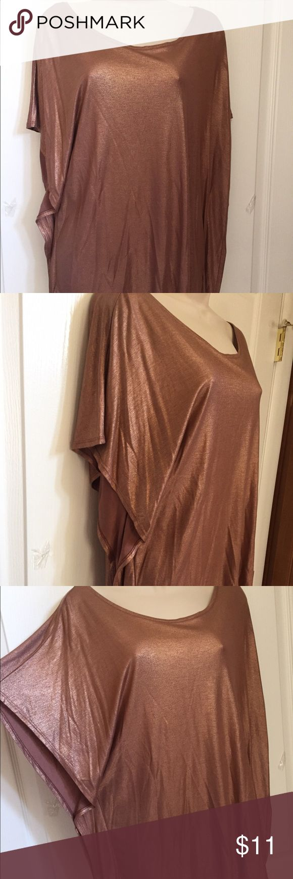 H&M Bronze Flowy Tunic Bronze dressy shirt, very comfortable, only worn a few times. Looks great with jeans and black pants. Great condition. XS but oversized, so could fit S too. H&M Tops Tunics