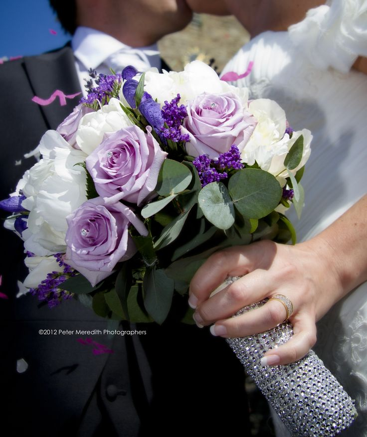 Purple and ivory hand tied with roses and limonium and diamonte detail www.flowerartbycatrin.com