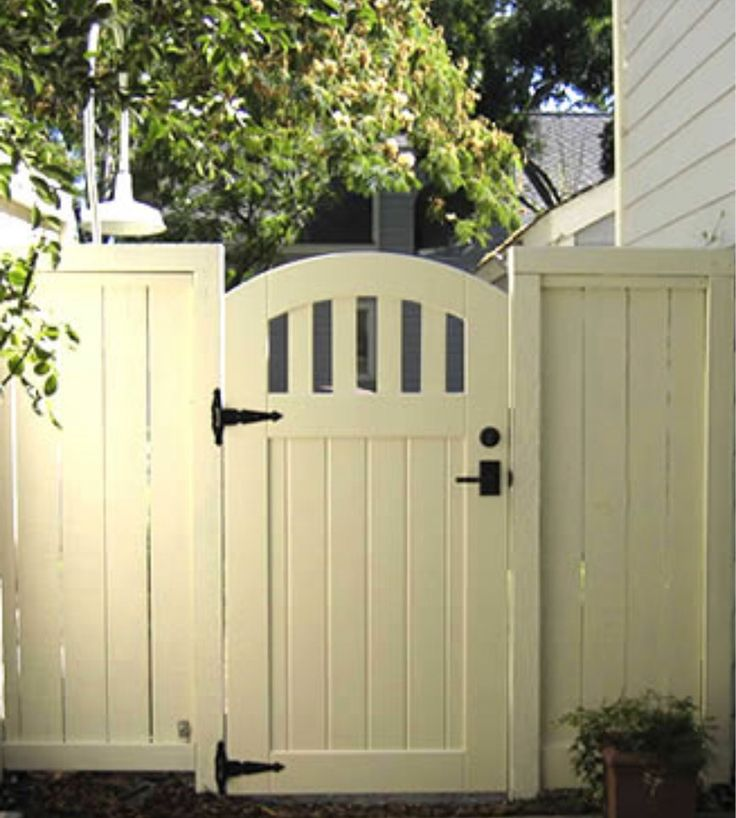 Cottage-y gate, with arch top.
