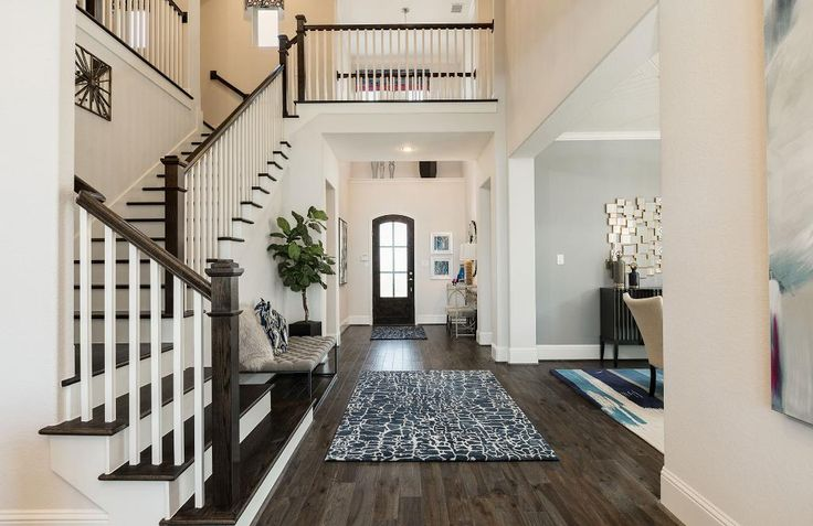 Two-story foyer white foyer with hardwood floors; The Sorenna floor plan, Drees Custom Homes, Houston