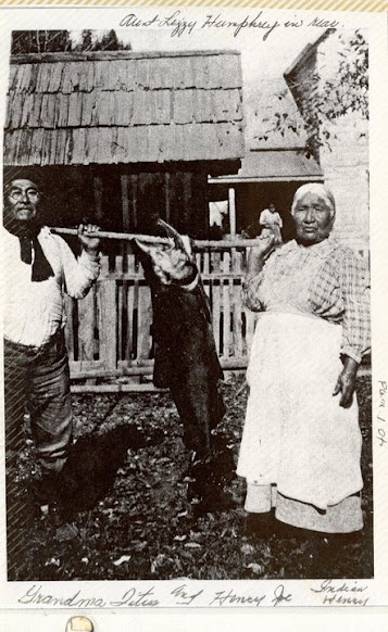 Henry Joseph Titus and his wife, Julia Titus holding a Salmon, with Lizzy Humprey standing in the background - Karuk - no date