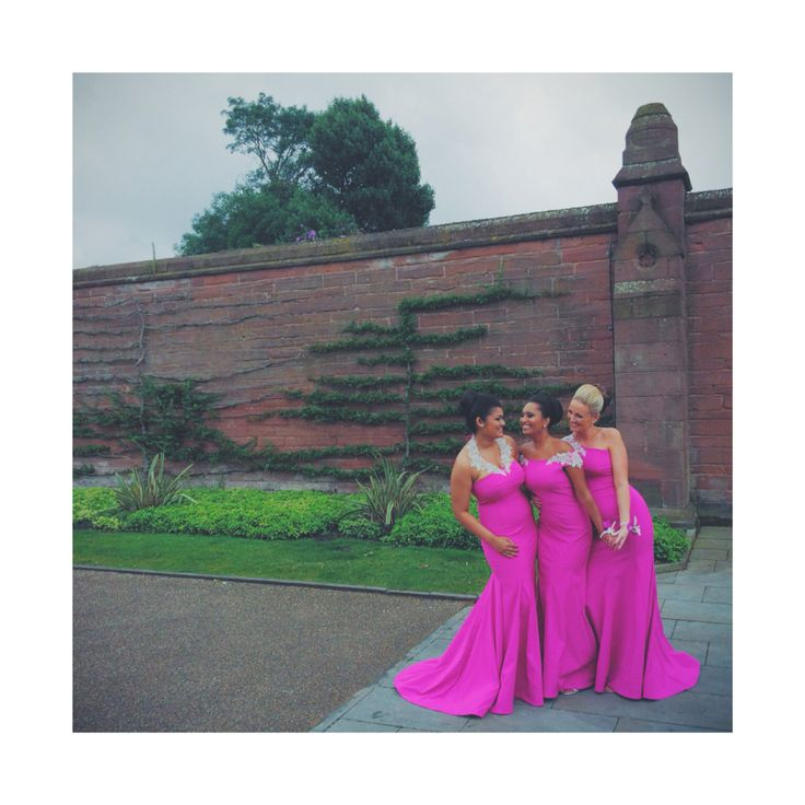 Kirsty Doyle bespoke bridesmaids in fuschia pink, all bodices slightly different to suit each girl. All finished with hand embellished crystal detailing. #kirstydoyle #bespoke #bridesmaids