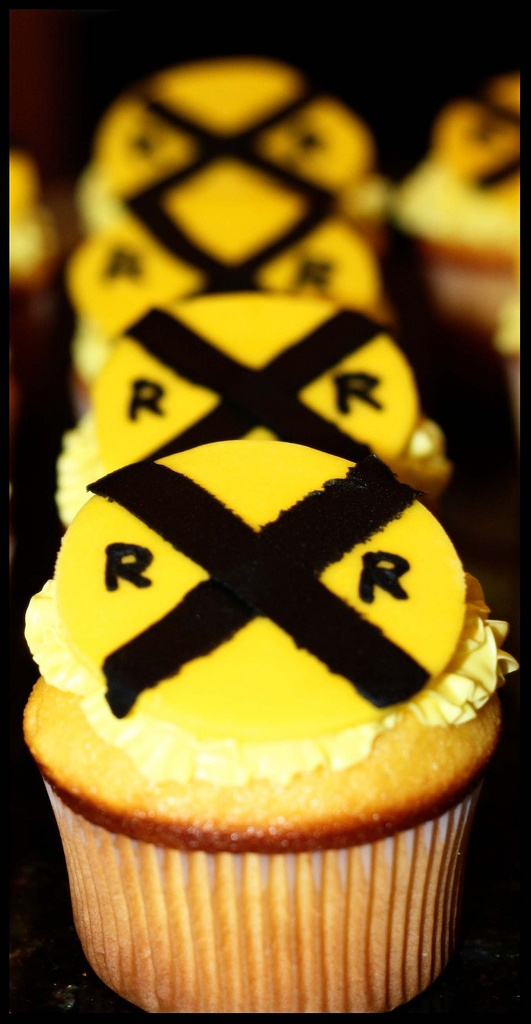 Birthday cupcakes - can do with the yellow colored chocolate chips you melt, with black frosting tubes