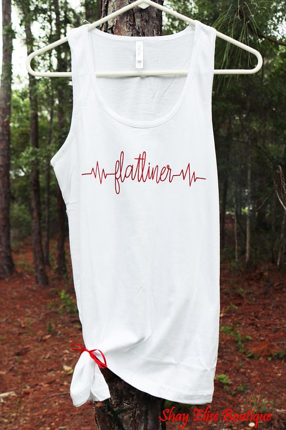 Somebody better call a doctor Shes a little heart stopper Im talkin breaker breaker one-niner Shes a FLATLINER.  Sparkle Red Glitter lettering make this shirt stand out and is perfect for that Dierks concert coming up! Into line dancing? You know you need this! Shirts can come in either black or white.  Have another song you like? Message me and we can come up with something one of a kind