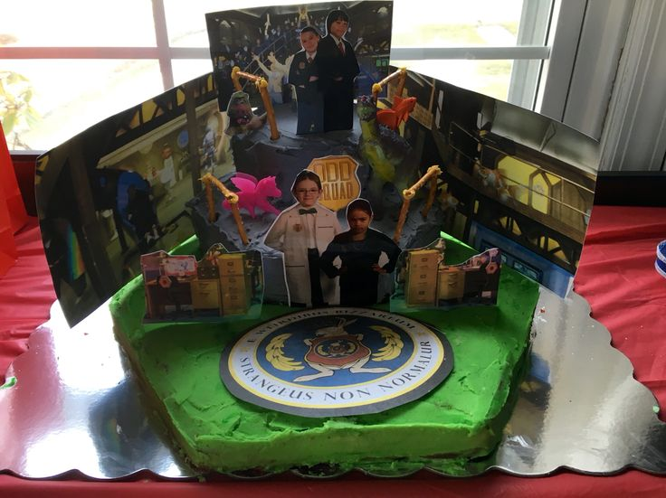 Odd Squad Cake Made With Photo Inserts And Toys Amp Pretzel