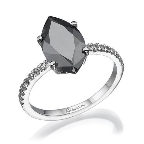 Marquise Black Diamond Engagement Ring white gold with white diamonds, Marquise ring, Solitaire ring, Antique Ring, Vintage Ring by gispandiamonds on Etsy. I'm not sure I like how large the black diamond is, I prefer a thinner marquise cut.
