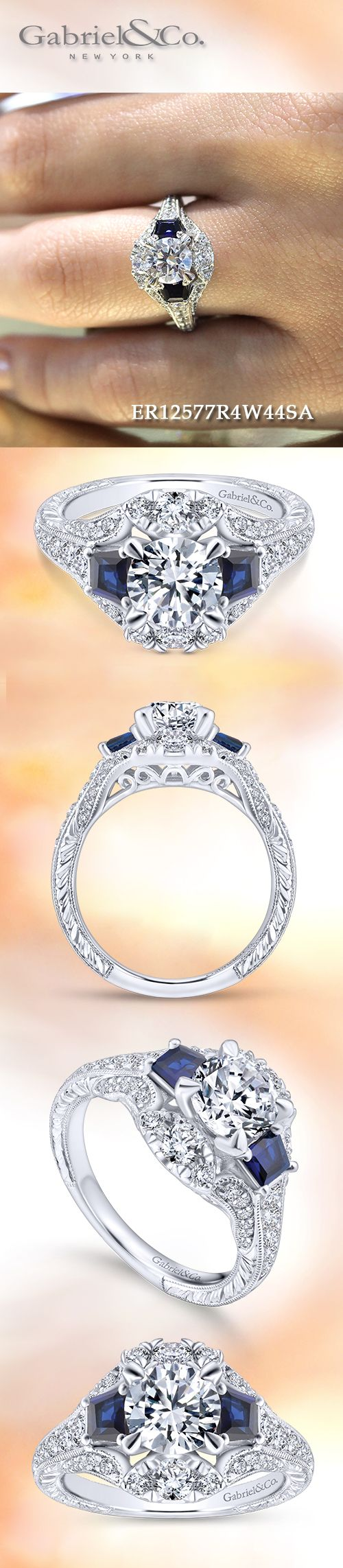 Gabriel & Co. - Voted #1 Most Preferred Bridal Brand. This luxurious three stone engagement ring has a round cut center stone joined by a pair of rich blue sapphires.