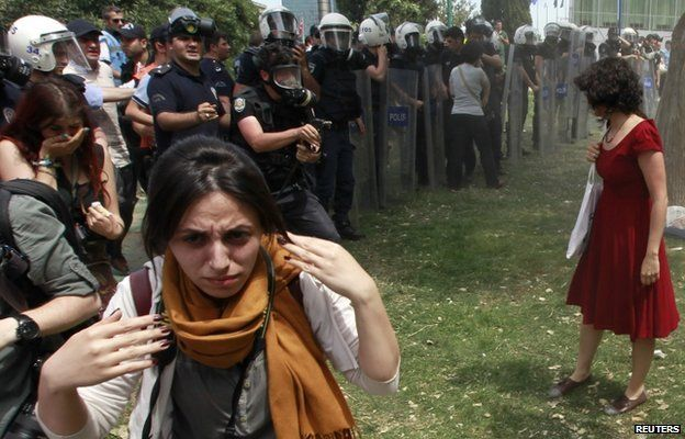 "The woman in red: Turkish prosecutors want a policeman to go to jail for three years for tear-gassing Ceyda Sungur who became known as the ""woman in red"", reports say. Source: BBC News/ Reuters"