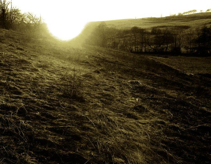 Soarele la asfintit, stirbind orizontul