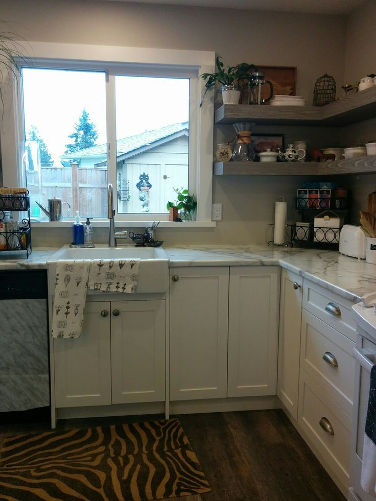 We love our IKEA farmhouse sink - best decision even though the kitchen cabinet maker didn't want us to use it.